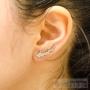 boucles d'oreilles longeant l'oreille